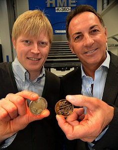 Artist Jonathan Wilkinson and Ashley Carson displaying the coins.